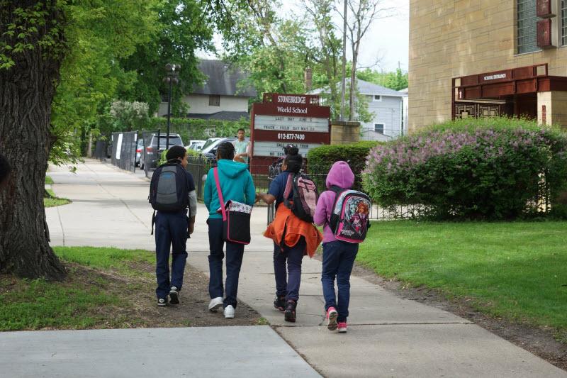 Stonebridge World School students walking to school building