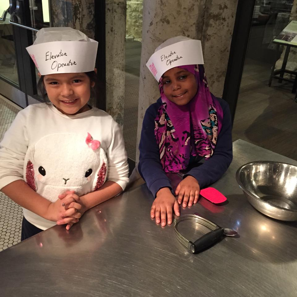 Students at Stonebridge World School getting ready to bake